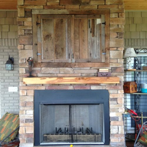 Outdoor fireplace on newly added on porch